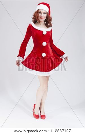 Happy Smiling Caucasian Female Santa Helper Posing Against White Background
