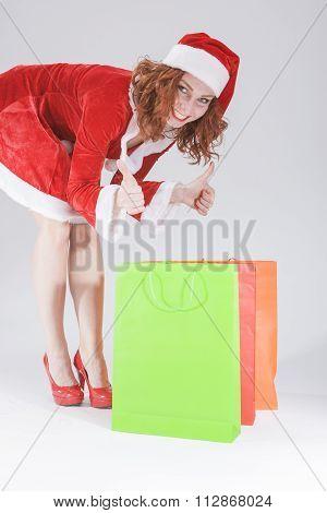 Happy Female Santa Helper with Plenty of Shopping Bags