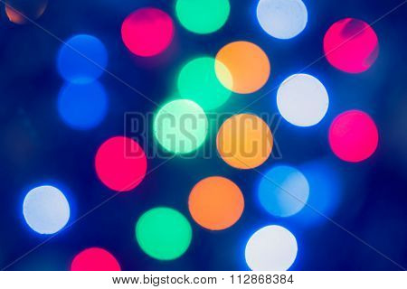 Abstract holidays wallpaper with beautyful bokeh and defocused lights toned image.