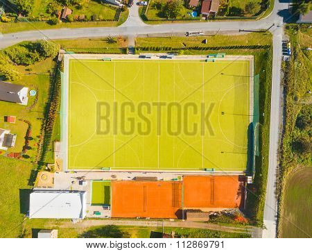 Aerial view of sports area with playgrounds and for soccer, tennis, volleyball and ground hockey in Pilsen suburb, Czech Republic, Europe.