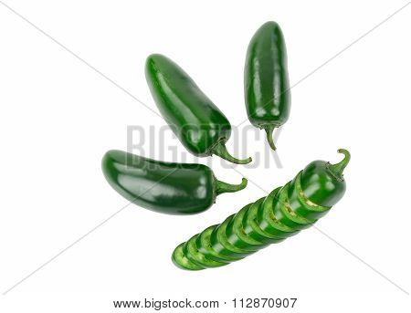 Four Green Jalapeno Peppers One Pepper is Sliced and stacked in Pepper Shape