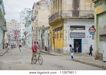 HAVANA, CUBA - DEC 4, 2015. People in an old decaying neighborhood in Havana, the capital and the largest city in Cuba as well as its main touristic destination.