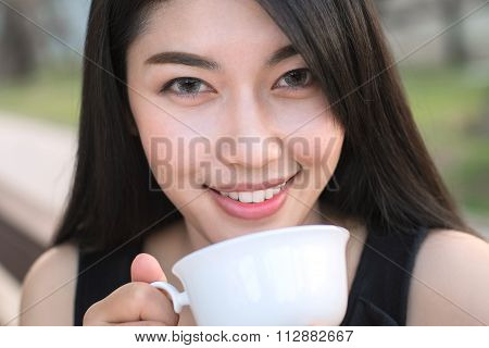 Woman Drinking Coffee For relax time.