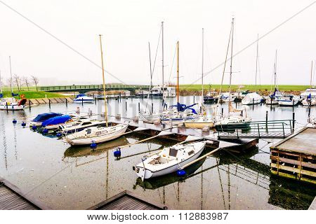 Malmo, Sweden - December 31, 2014:marina With Small Boats Anchored In Malmo In Sweden On A Cloudy Da