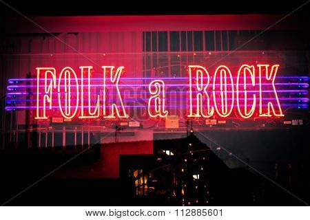 Malmo, Sweden - December 31, 2014: Neon Lighted Shop Window Of Music Store With Rock & Folk Music In