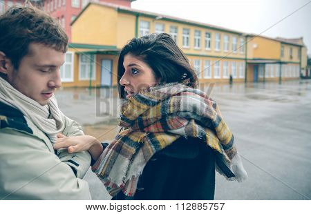 Angry woman having argument to man in quarrel
