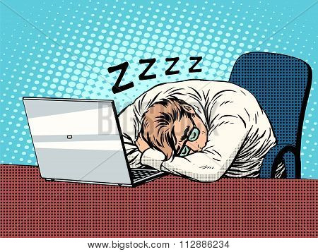 Businessman working on laptop fatigue sleep