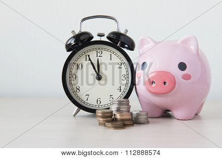 Time is money table clock with coins on white background