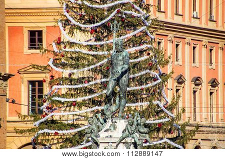 Bologna, Italy  - December 27, 2015:  The Neptune Fountain In Bologna With The Traditional Christmas