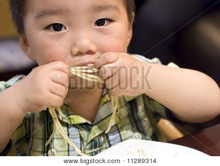 A Funny Baby Is Eating