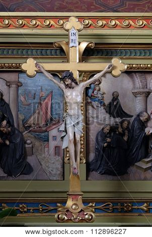 ZAGREB, CROATIA - MAY 28: Cross on the altar in the Basilica of the Sacred Heart of Jesus in Zagreb, Croatia on May 28, 2015