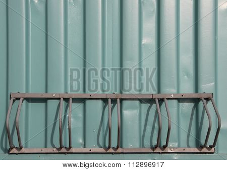 Empty Bicycle Rack Mount On Green Container