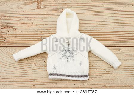 White Snowflake Hoodie Christmas Sweater On A Weather Wood Background