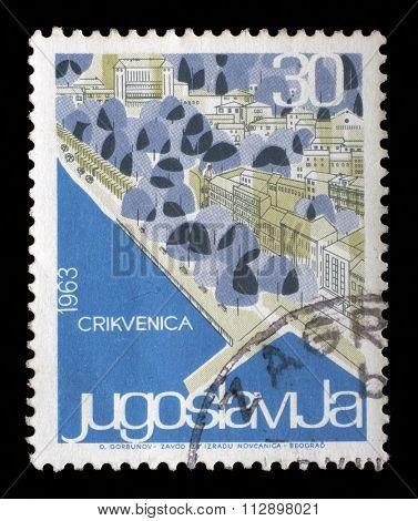 YUGOSLAVIA - CIRCA 1963: A stamp printed in Yugoslavia from the Local Tourism issue shows Crikvenica, Croatia, circa 1963.