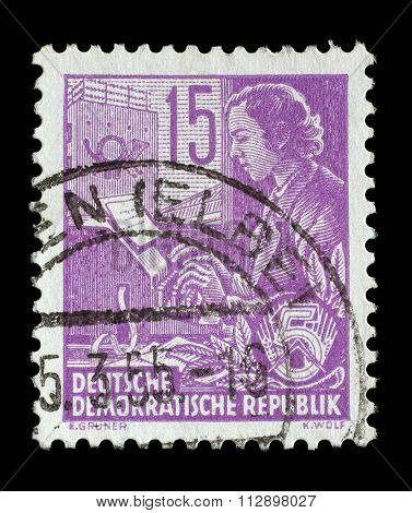 GDR - CIRCA 1953: A stamp printed in GDR (German Democratic Republic - East Germany) shows a Woman on the teletype without the inscription, from the series Workers For The Five-year Plan, circa 1953