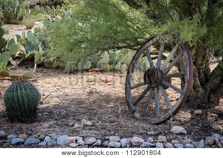 Old Wagon Wheel In The Desert
