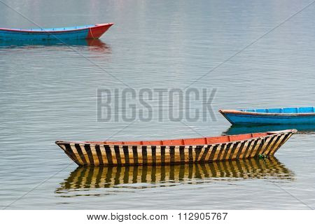 Small boat on Fewa Lake in Pokhara, Nepal