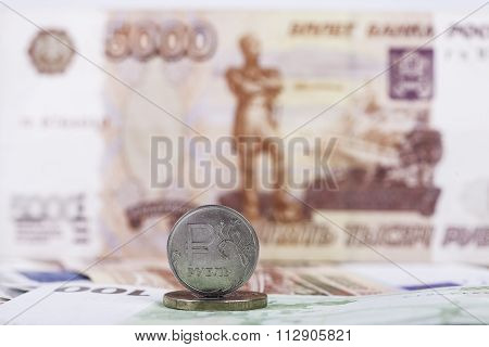 ruble coin on the background of banknote 5000 rubles closeup