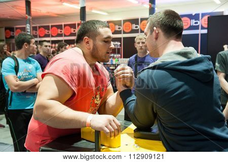 MOSCOW, RUSSIA - NOVEMBER 21, 2015: Men compete in armwrestling at exhibition of sports nutrition SN Pro Expo Forum 2015 on November 21, 2015 in Moscow, Russia