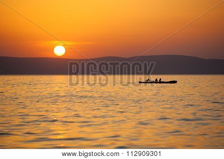Sunset With Paddlers