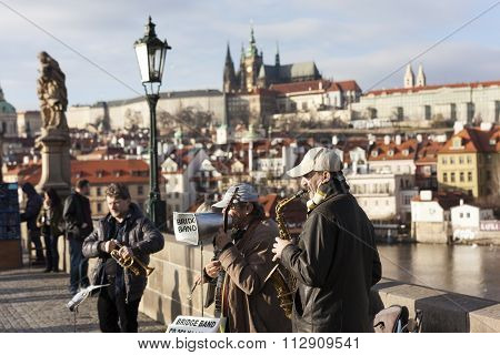 PRAGUE, CZECH REPUBLIC - DECEMBER 23, 2015: Photo of Street musicians on the Charles Bridge.