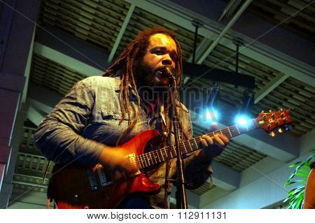 Reggae Band Guidance Band Lead Singer Keith Batlin Sings Into Mic