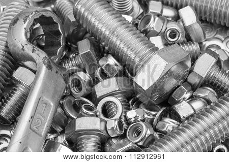 Industrial strong steel nuts bolts and washers mixture with a spanner
