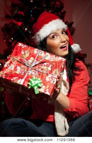 Excited Woman Lifting Her Christmas Present