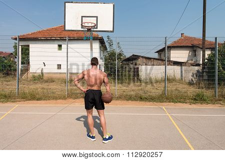 Bodybuilder Playing Basketball Outdoor
