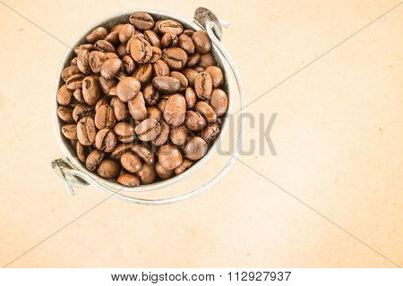 Coffee Roasted Bean In The Bucket On Wooden Background
