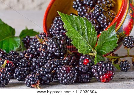 Blackberries On The Old Wooden Table In Traditional Russian Dish