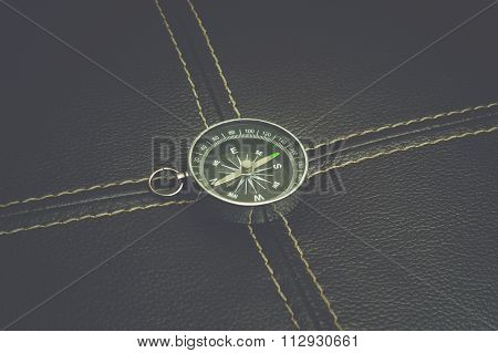 Compass on the black leather background. A classsic look with instagram film effet.