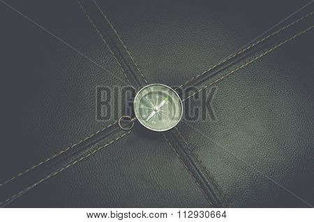 Compass on the black leather background. A classsic look with instagram film effect.