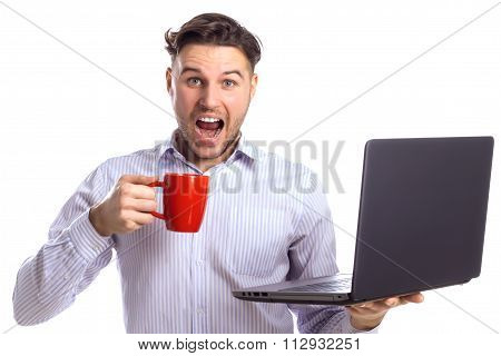 Handsome Surprised Businessman Holding Red Cup And Laptop
