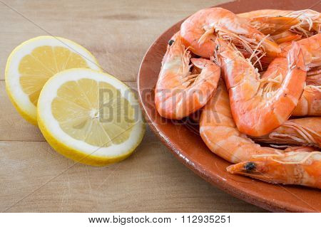 Boiled Shrimp With Lemon Arranged On Kitchen Board