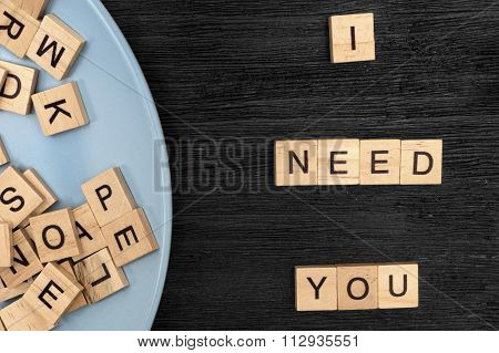 Wooden Letters Spelling I Need You