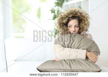 Woman Warmly Clothed In A Cold Home