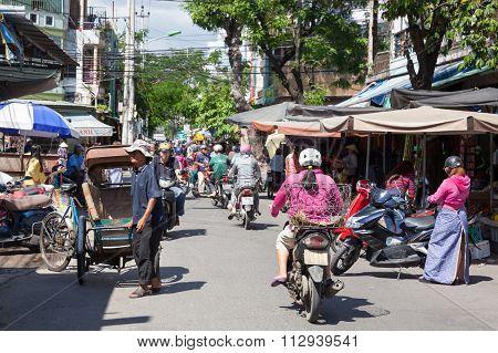Rickshaw with his three-wheeled passenger cart on the street