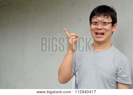 Asian Man with ideas finger pointing upwardss