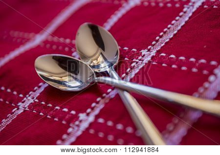 Teaspoons On A Red Tablecloth