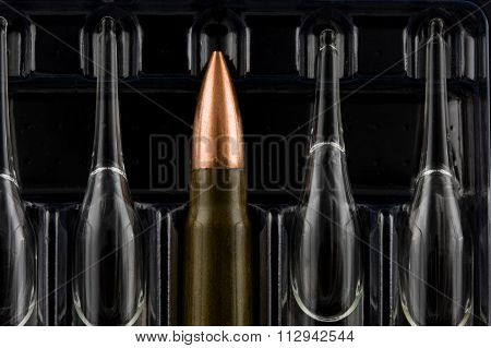 Macro Of Bullet Among Ampoules