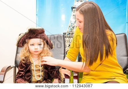 Little Girl Child Dressed As Pirate For Halloween With Mom. Kid In Carnival Costumes For Christmas