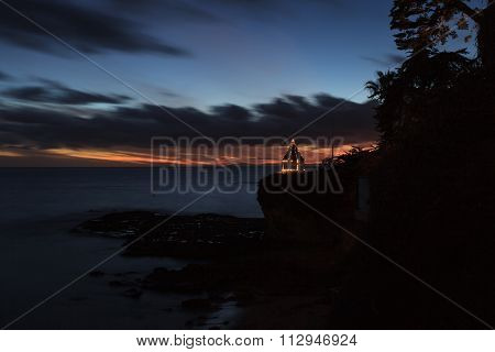 A gazebo on a cliff overlooking the ocean