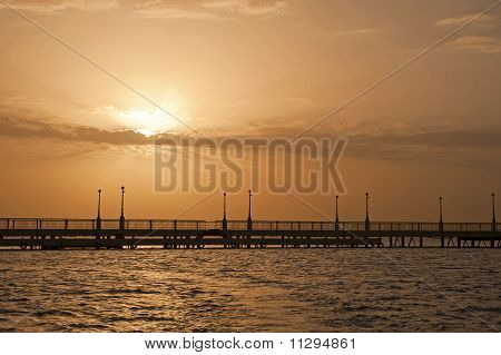 Sunrise Over The Ocean At A Pier