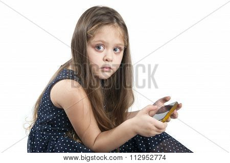 Portrait Of Little Blue-eyed Girl With Mobile Phone In Hand..
