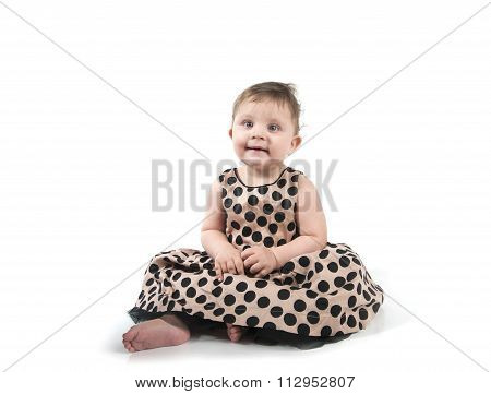 Baby Sitting On The Floor In A Beautiful Dress..
