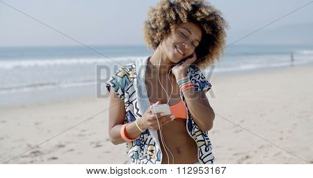 Close-up portrait of young happy woman talking on mobile phone on the beach in slow motion,