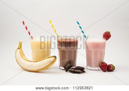Fruits and Milkshakes on white background