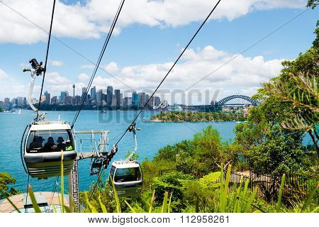 The Sky Safari cable car at Taronga Zoo in Sydney with Opera House and Harbour Bridge in background