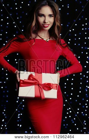 Woman Wears Elegant Dress And Bijou, Holding Present With Red Bow